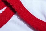 """Detail Roter Strampler """"Wunschkind"""""""